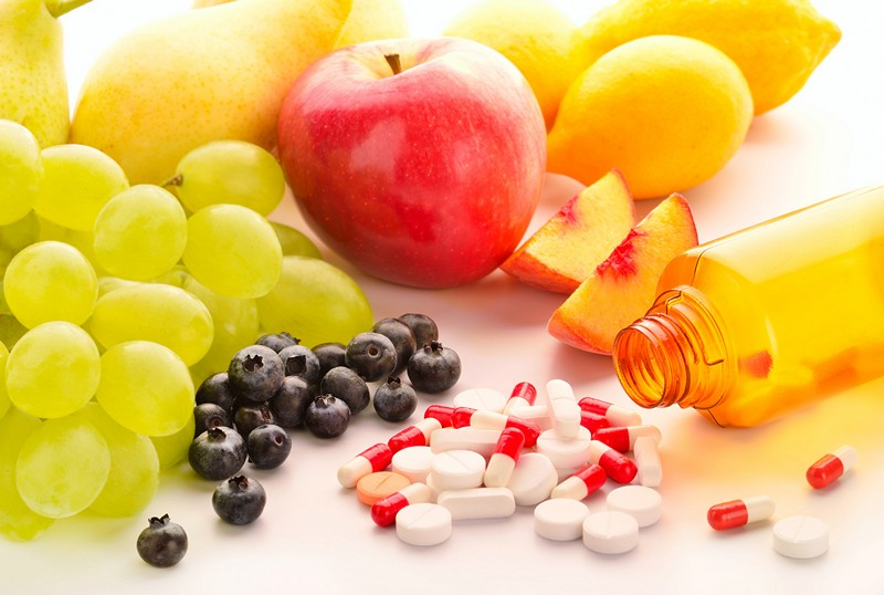 Vitamin pills with fresh fruits